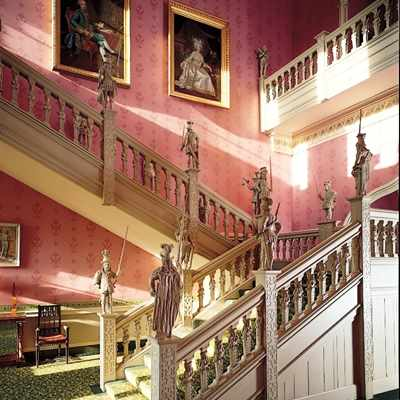 Staircase showing portraits at Hartwell House